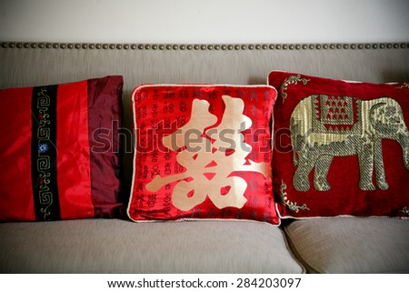 Chinese Wedding Tea Ceremony Red Pillows and Couch