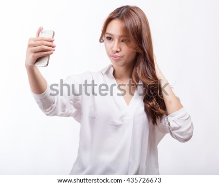 Chinese woman taking selfie with a smart phone