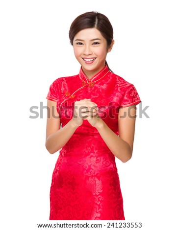 Chinese woman with blessing gesture for lunar new year