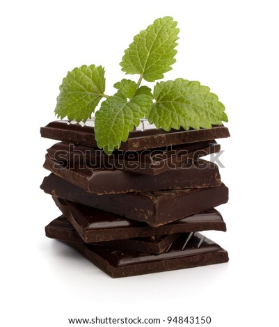 Chocolate bars stack and mint leaf isolated on white background