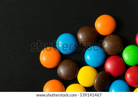 Chocolate colorful on black background, Sweet candy.
