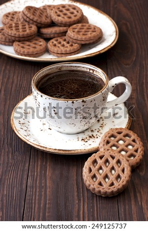 Chocolate cookies and cup of aromatic coffee