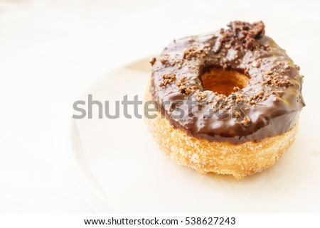 Chocolate donut on white table