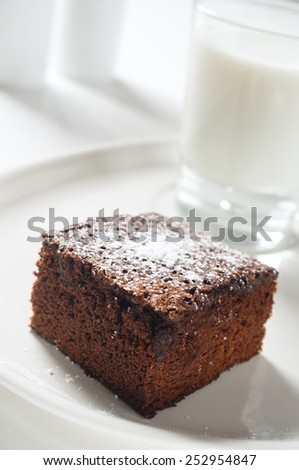 Chocolate fudge brownies with milk in a high key light