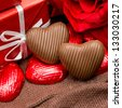 chocolate, gift box and flowers for Valentine's day - stock photo