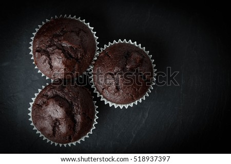 Chocolate muffin on dark background. Shallow depth of field. Top view.
