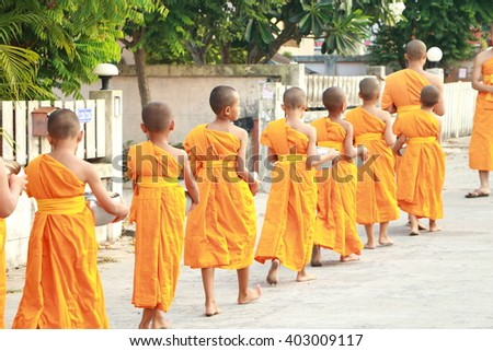 CHON BURI - THAILAND - APR 09 - 2016 : Monks walking for receive food from the people in morning time during Songkran festival in Thailand