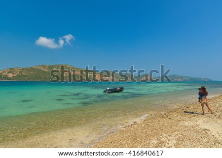 CHONBURI, THAILAND -  APR 17, 2016: Women photographs on the camera procession the sea view point and boat at Koh Kham. During the long weekend Many people Travel for pleasure