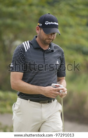 CHONBURI, THAILAND - DECEMBER 15: Sergio Garcia of Spain reacts after a putt during Day 1 of Thailand Golf Championship on December 15, 2011 at Amata Spring Country Club in Chonburi, Thailand