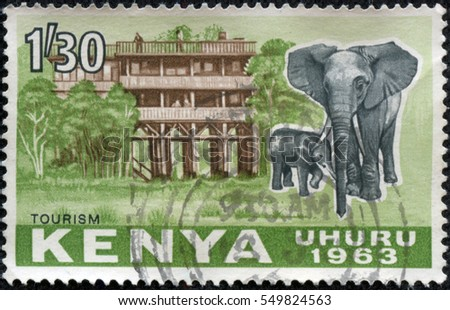 CHONGQING, CHINA - May 11, 2014:A stamp printed in Kenya, shows an African Elephant (Loxodonta africana) in front of a Hotel, circa 1963