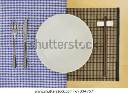 chopsticks, knife, fork, plate showing fusion cooking concept