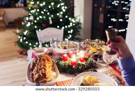 Chrismas meal laid on a table in a decorated living room