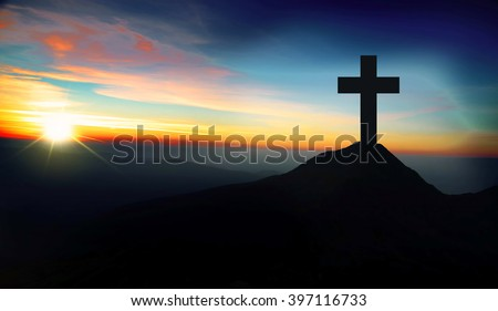 Christianity concept with christian cross silhouette on the hill on sunset