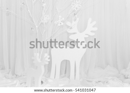 Christmas background deer in a snowy forest