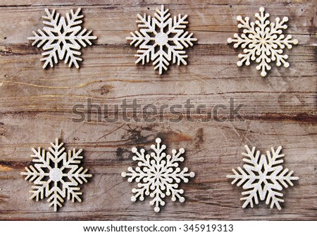 Christmas background: snowflakes on rustic wood