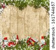 Christmas background with a border of fir branches and decoratio - stock photo