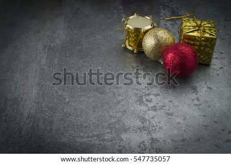 Christmas background with decorations and gift boxes on grey board