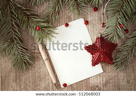 Christmas background with fir branch, red star and paper with pen for your text