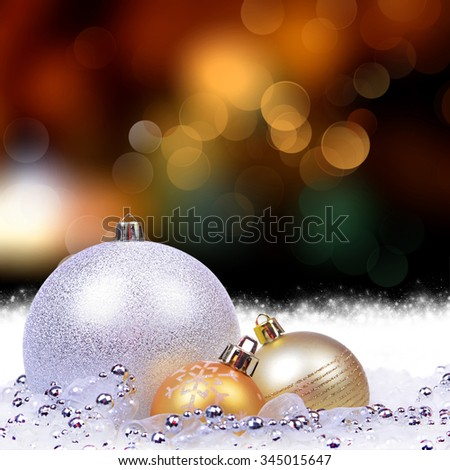 Christmas background with golden balls, silver balls and bokeh lights