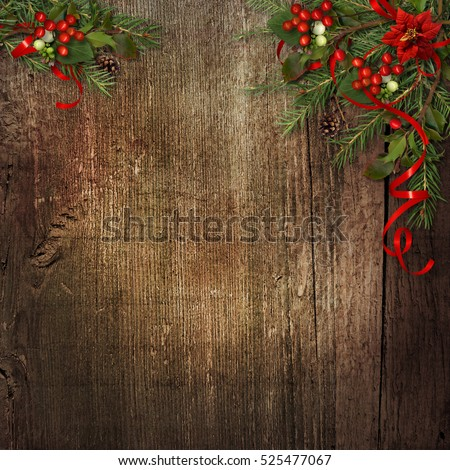 Christmas background with poinsettia, mistletoe,holly on grunge wood