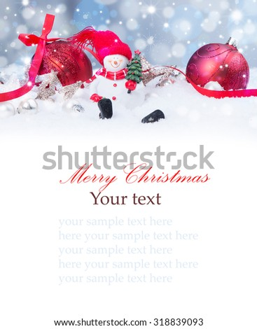 Christmas background with red baubles,snow, snowman and snowflakes, free space for text. Christmas decoration.