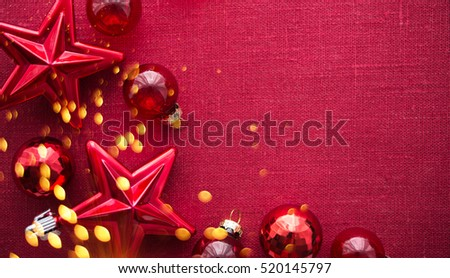 Christmas background with red ornaments and sparkle bokeh lights on red canvas background. Merry christmas card. Winter holiday theme. Space for text. Happy New Year.