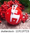 Christmas ball decoration with deer and  red berry branches - stock photo