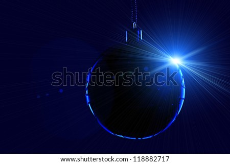 Christmas ball in contour light with lens flare on black background