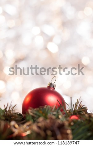Christmas ball on wreath with abstract light background