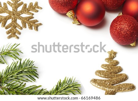 Christmas balls and pine branch aranged on  white background.