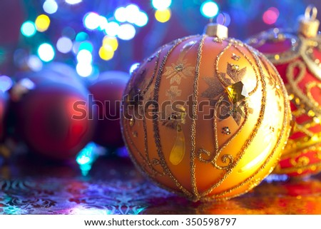 Christmas baubles on lighting background