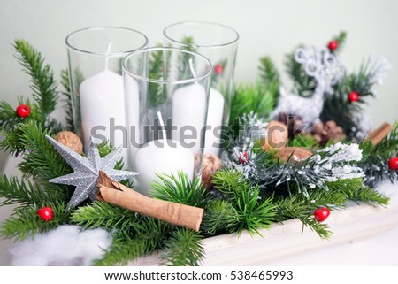 Christmas composition with white candle and deer