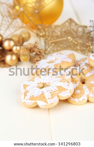 Christmas cookies and decorations on color wooden background