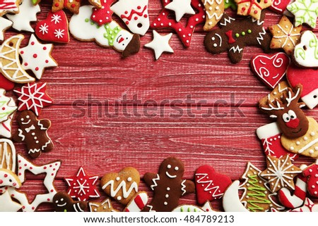 Christmas cookies on a red wooden table