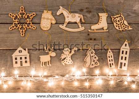 Christmas decoration and lights on the wooden background