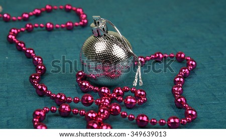 Christmas Decoration: colorful Christmas ball and ornaments on textured background