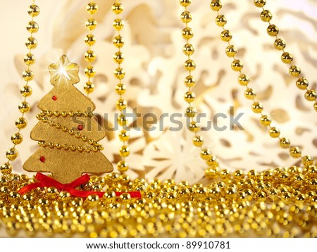Christmas decoration, gold holiday background with firtree & snowflake