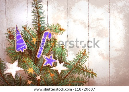 Christmas decoration over grunge background/vintage paper christmas decoration on christmas tree