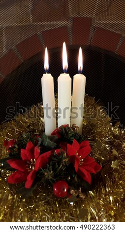 Christmas decoration three candles with tisel and red