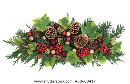 Christmas decoration with red and gold bauble decorations, holly, ivy, gold pine cones, cedar cypress and fir leaf sprigs over white background.