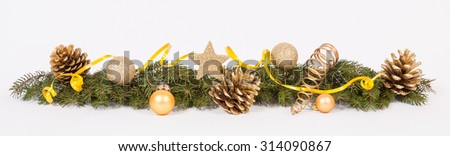 Christmas decoration with the twigs of the spruce, cones and baubles