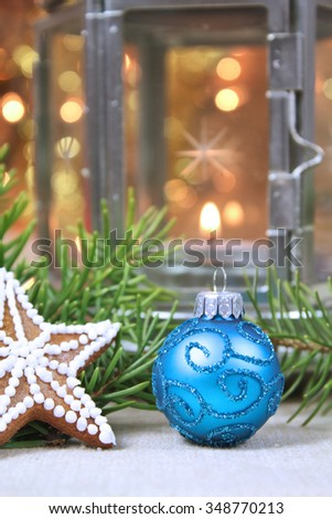 Christmas decorations background. Blue glass bauble, gingerbread and candle