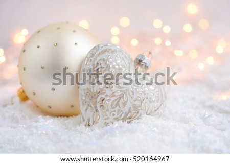 Christmas decorations on snow and Christmas lights. Festive Christmas background