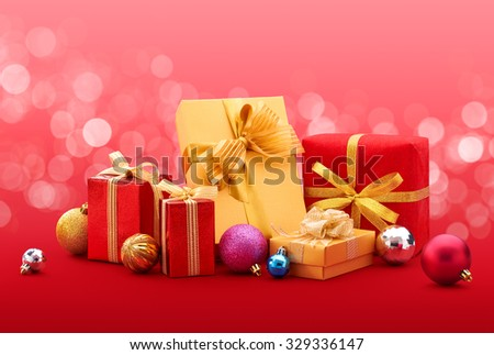 Christmas gift and baubles on red color background