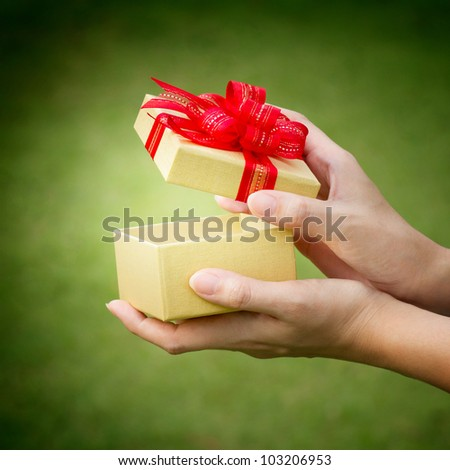 christmas gift box with hand open