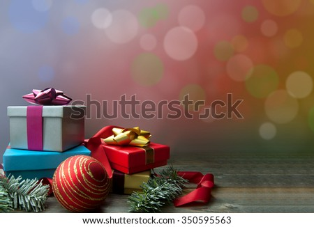 Christmas gifts and decorations with bokeh background space
