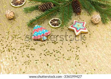 christmas gingerbread holiday decoration on festive background with golden stars