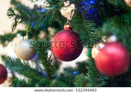 Christmas holiday decorative purple and gold balls on a pine tree