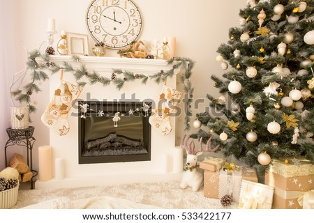 Christmas interior with fireplace and xmas tree.