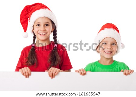 Christmas kids standing with empty horizontal banner in hands, isolated on white